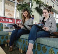 Junior Courtney Mahr, left, and freshman Toria Lodzinski peruse Time magazine.