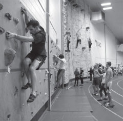 UWRF students utilize the indoor climbing wall while participating in the Wellness Challenge.