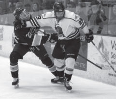 Sophomore forward Mitch Kontny stiff arms a UW-Eau Claire opponent in a 4-3 loss to the Blugolds at Hunt Arena on Saturday, Jan. 24.