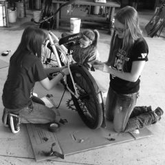 River Falls High School National Honor Society students help fix up the donated bikes for the Blue Bike Program.