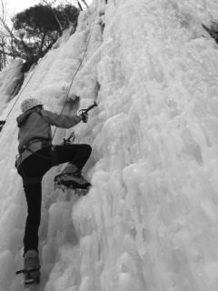 A climber from UWRF ascends an icy cliff face during the Falcon Outdoor Adventures annual ice climbing trip to Sandstone, Minnesota. (Photo courtesy of Falcon Outdoor Adventures)