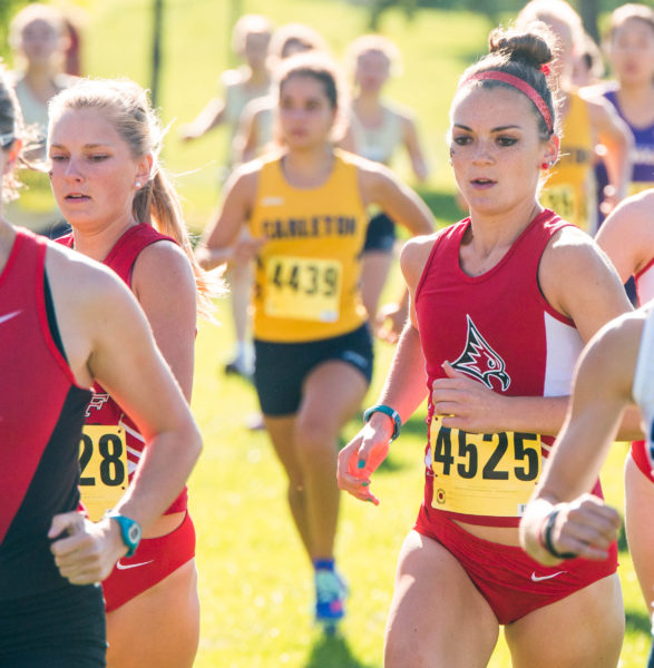 Linsey Tolkkinen, left, and Abby Fouts run at the Falcon Invitational on Sept. 8. Photo by Tori Schneider