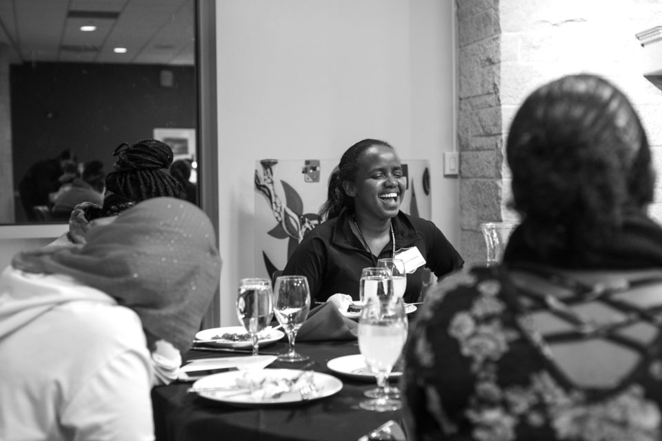 Ibrahim laughs with others during an Aspire event in the University Center.