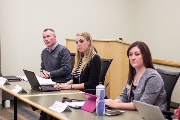 Assistant Chancellor for Student Affairs Gregg Heinselman (left), UWRF student body vice president Kaylee Kildahl and UWRF student body president Abby Wendt, listen during a Student Government Association meeting Nov. 14. Photo courtesy of Anja Gridley