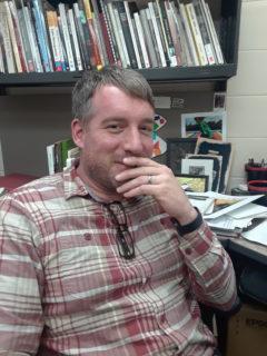 Brett Kallusky is an assistant professor of art. (Photo by Kacey Joslin)